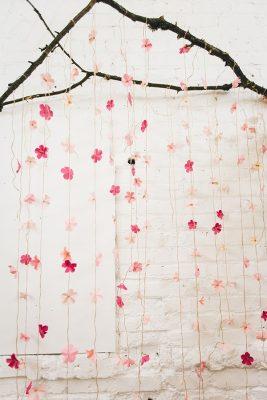 DIY Paper Cherry Blossom Backdrop - photo by Jenn Byrne Creative http://ruffledblog.com/diy-paper-cherry-blossom-backdrop